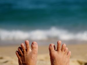 bare foot on the coast
